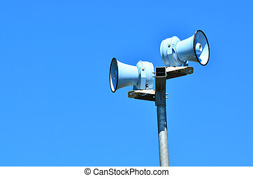 Air raid siren against blue sky - Air raid siren , against...