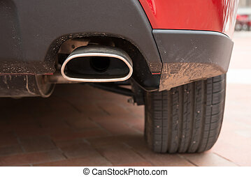 exhaust pipe of a red car