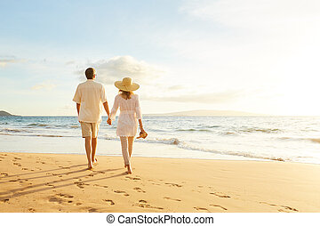 Mature Couple Walking on the Beach at Sunset - Happy...