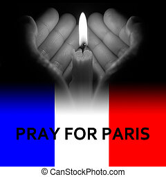 hands holding a burning candle in dark like a heart in grey tone with pray for Paris on bottom