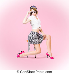 Beautiful pinup girl with beauty hair and make-up - Pink pop...