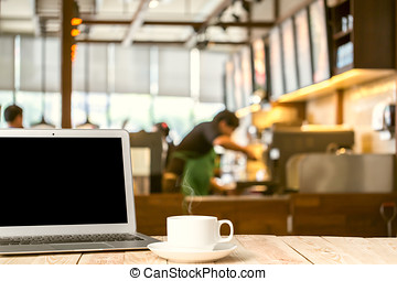 Laptop with tablet, pen and a cup of fresh coffee latte art...