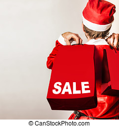 Santa helper with gifts at Christmas shopping sale - Cute...