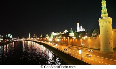 Panorama of the Kremlin towers, river and cars on road in Moscow
