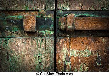 Rusted latch - Extreme close-up of a rusty latch, mounted on...