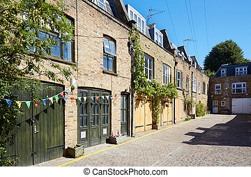 Bricks mews houses in London in a sunny day, England