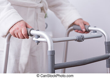 Disabled person with walking zimmer - Close up of disabled...