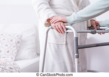 Walking problem and zimmer - Image of woman with walking...