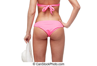 close up of young woman buttocks in pink bikini - people,...