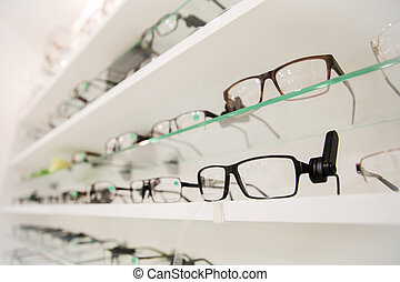 close up of eyeglasses at optician - optics, health care and...