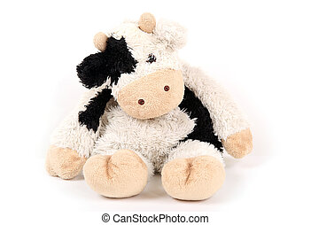 White toy cow with black spots toy.