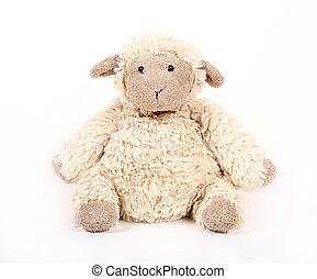 Fluffy white toy sheep.