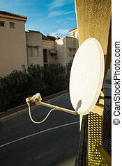 Satelite dish - Domestic satelite dish on a home exterior