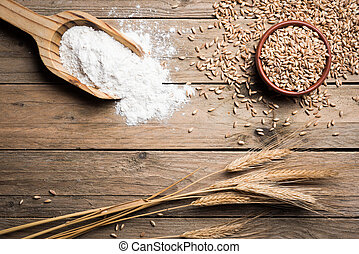 Ear wheat - Ear grains, flour and wholegrains on wood table