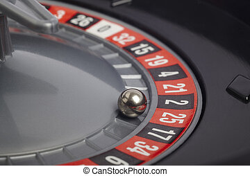 Casino roulette detail with ball in number twenty-five...