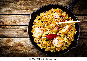 pilaf in a pig-iron frying pan. top view. style rustic....
