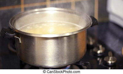 cook pasta in a saucepan of boiling water