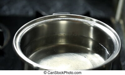 clean boiling water in a pan