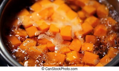 sliced pumpkin cubes in boiling water
