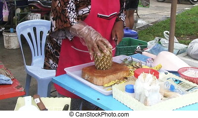 Woman Cutting Pineapple
