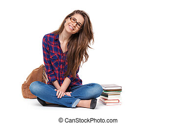 Portrait of happy female student sitting isolated. -...