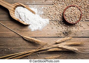 Ear wheat - Ear grains, flour and wholegrains on wood table