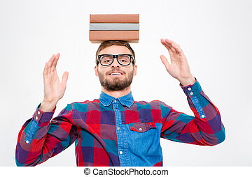 Happy amusing man in glasses with books on his head - Happy...