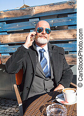 Businessman outdoor - Middle-aged man , handsome and elegant...