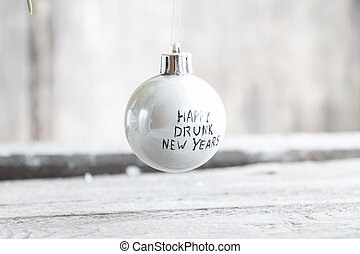 Happy Drunk New Years text on a christmas balls