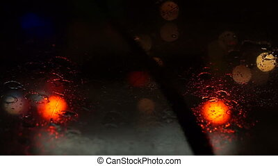 Rain wipers car on street - Video of beautiful colorful...