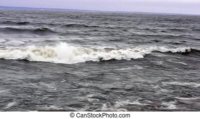 Stormy wave on lake - Stormy lakeside park in surprisingly...