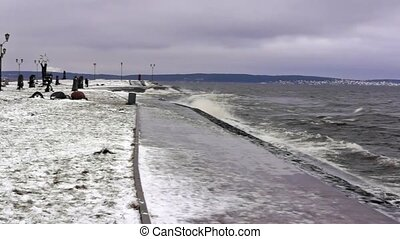 Winter stormy waves on lake - Stormy lakeside park in...