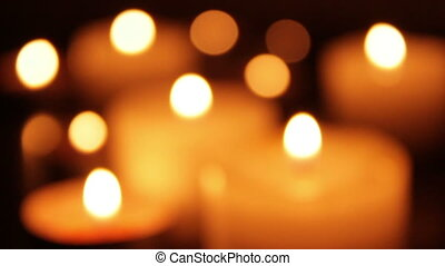 Wind blowing on candles and shaking a flames soft focused...