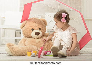 Little girl playing with teddy bear - Lovely little girl...