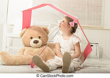 Little girl playing with teddy bear - Expressive beautiful...