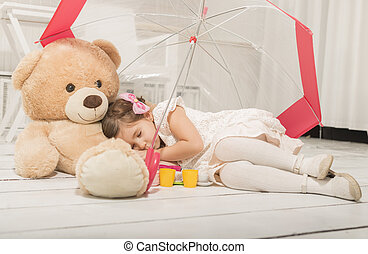 Little girl sleeping under umbrella - Beautiful little girl...