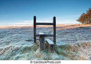 Frosty Stile - A frosty stile over a barbed wire fence on a...