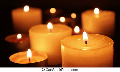 Many Candles Burning In A Dark