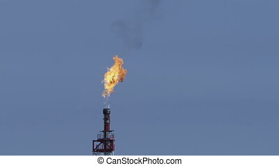 Flare on an oil rig - The combustion gas on an oil rig