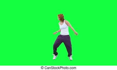 Dancing woman isolated on green