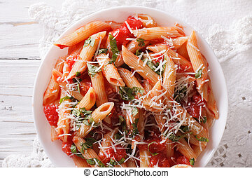 Arrabiata pasta penne with Parmesan cheese closeup....