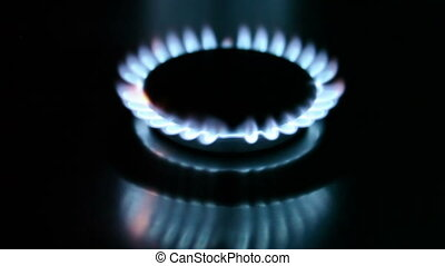 The burning torch on the gas stove - The burning torch on...