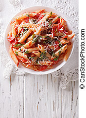 Arrabiata pasta penne with Parmesan cheese. vertical top...