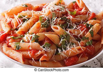 Arrabiata pasta penne with Parmesan cheese macro horizontal...