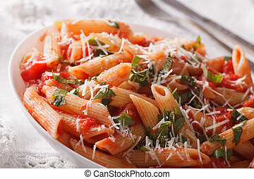 Arrabiata Pasta with Parmesan on a plate macro horizontal -...