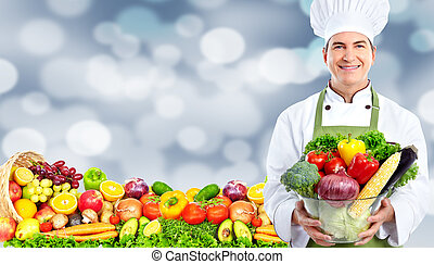 Chef man with vegetables - Handsome Chef man over abstract...