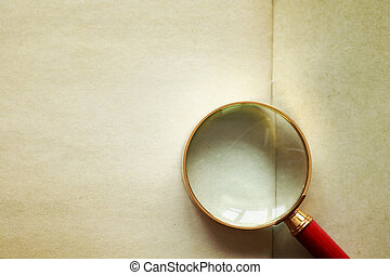 Magnifying Glass On Old Paper