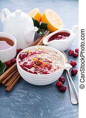 Christmas morning breakfast oatmeal with cranberry sauce and...