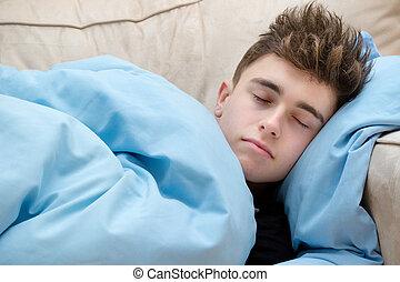 Teenage Boy Asleep On A Sofa