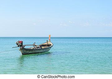 Traditional thai longtail boat at Naiyang beach,Phuket in Thailand